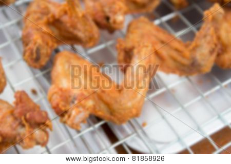 Blurry Image Of Fried Chicken Wing Limb