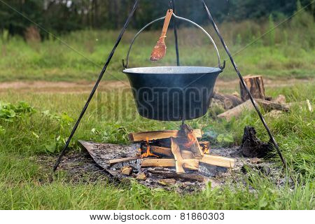 Camp fire outdoors burning with pot