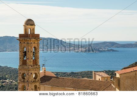 Church Tower Of Lumio With Calvi In Background