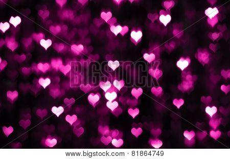 Dark valentine background with purple hearts