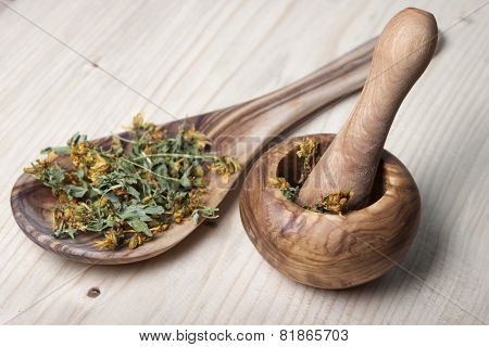 Mortar With Pestle, Wooden Spoon Of Olive Trees,  And Dry Grass Hypericum.