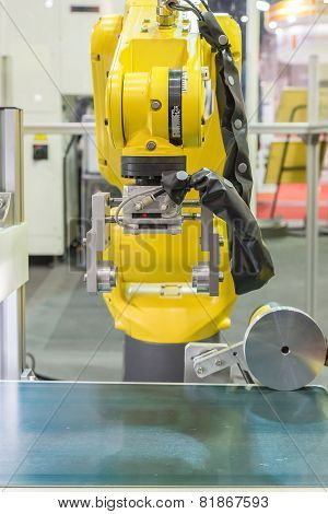 Automatic Robot Arm With Optical Sensor Working In Factory