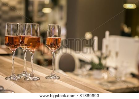 Glasses With Wine On Wooden Table, Closeup Vintage Style