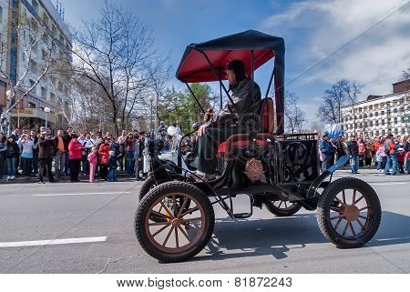 Retro car of 19 century participates in parade