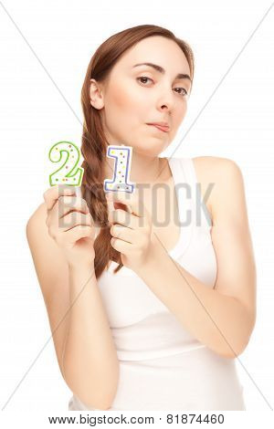 Beautiful Woman Showing Her Tongue With Two Candles Isolated
