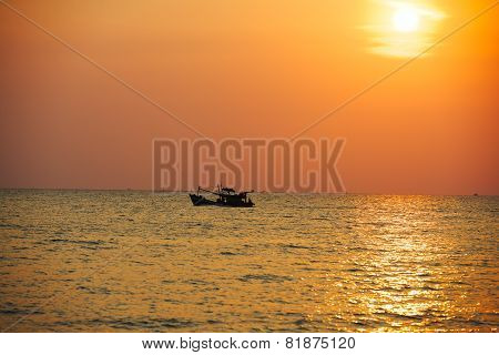 Fishing schooner at sunset
