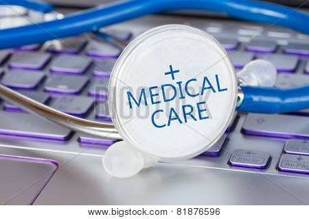 stethoscope on notebook keyboard