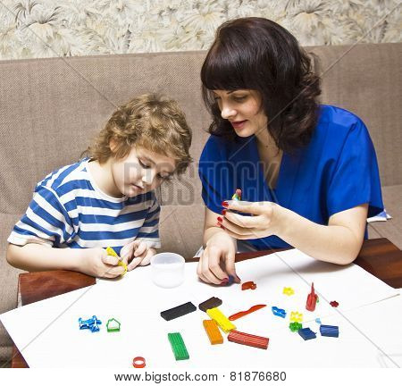 Mother And Son Modelling With Plasticine