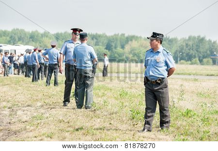 Policemen stand in cordon