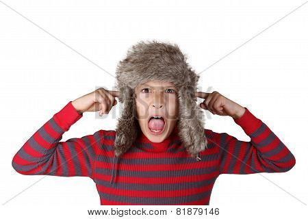 Boy in furry hat pulling funny face
