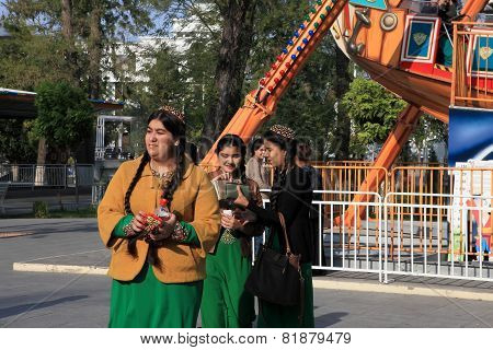 Ashgabad, Turkmenistan - October 10, 2014. Unidentified Schoolgirls  In National Dress Are Having Fu