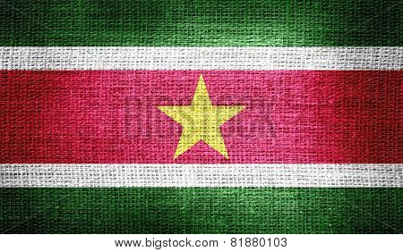 Suriname flag on burlap fabric