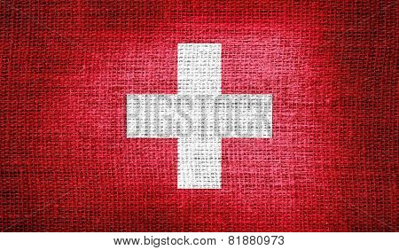 Switzerland flag on burlap fabric