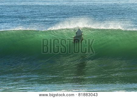 Surfer Aborts Wave Ride