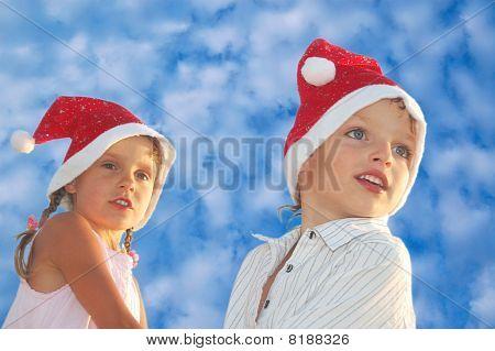 Christmas Children Agaist The Blue Sky