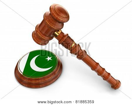 Wooden Mallet and Pakistan flag (clipping path included)
