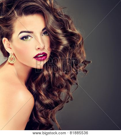 Beautiful model brunette with long curled hair