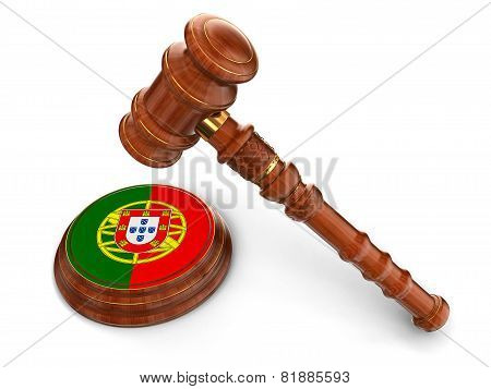 Wooden Mallet and Portuguese flag (clipping path included)
