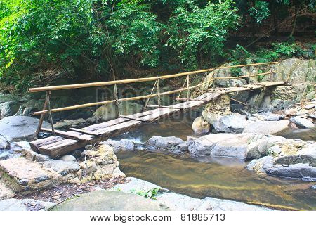 Wooden Bridge Over The Stream