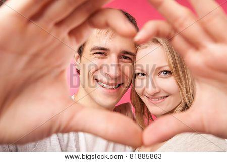 Girl and her boyfriend making heart