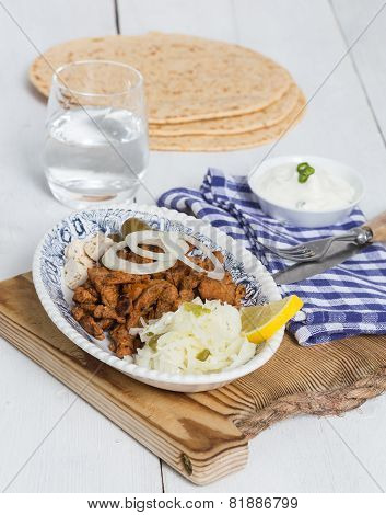 Gyros With Tzatziki Coleslaw Olives And Feta Cheese