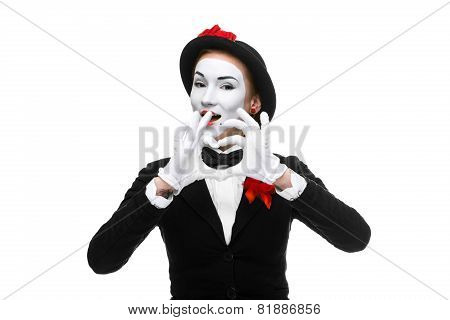 Portrait of the mime  with hands folded in  shape as a heart