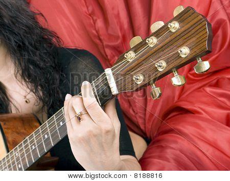 plays a guitar