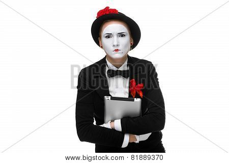 woman in the image mime holding tablet PC