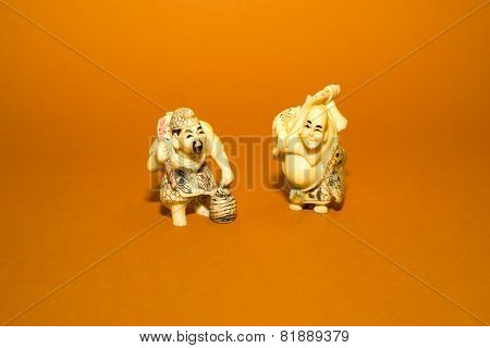 Two Figures Of Chinese Men On A Orange Background