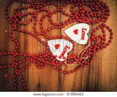 Hearts On Wooden Board
