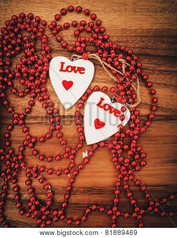 Two Hearts On Wooden Board