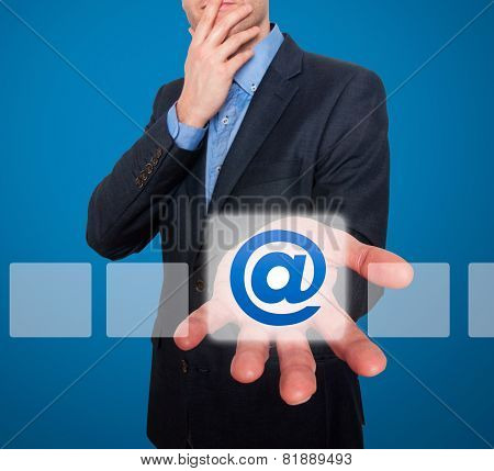 Email and contact symbols in front of businessman - Stock Image