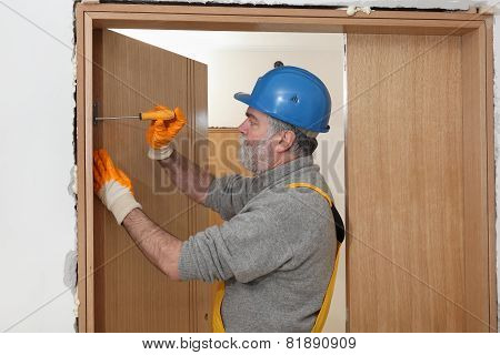 Worker Install New Door