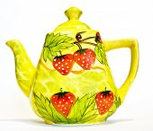 stock photo of paint pot  - Tea pot yellow colour with painted red strawberry - JPG
