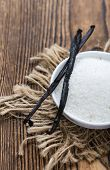 pic of white sugar  - White Vanilla Sugar on rustic wooden background - JPG