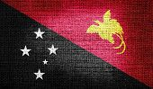 pic of papua new guinea  - Grunge of Papua New Guinea flag on burlap fabric - JPG