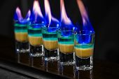 stock photo of absinthe  - Alcoholic cocktail shots with absinth in nightclub - JPG