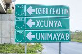 picture of yucatan  - Directional sign off highway 261 to Merida with arrows indicating way to Dzibilchaltun Xcunya and Unimayab in Yucatan - JPG