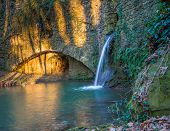 picture of water-mill  - Ruins of a water mill in Tuscany with a waterfall that passes through - JPG