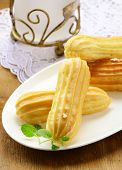 foto of eclairs  - choux pastry dough eclairs with vanilla cream - JPG