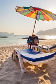 image of phi phi  - a plastic chaise lounge on a tropical beach on sunset in Phi Phi Island Thailand