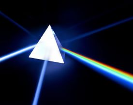 pic of prism  - A pyramid prism photographed on black with light split into colour spectrum - JPG