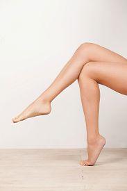 picture of crossed legs  - Beautiful legs - JPG