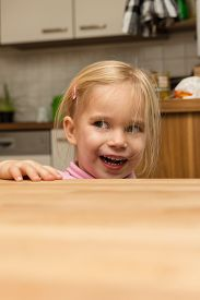 image of cheeky  - a cheeky blond girl with unkempt hair - JPG