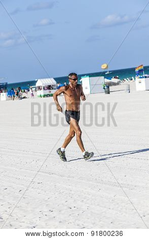 Jogging Man In The Afternoon In South Beach