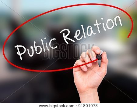 Man Hand writing Public Relations with marker on transparent wipe board.