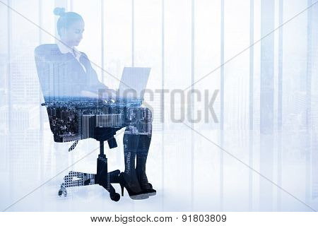 Businesswoman sitting on swivel chair with laptop against high angle view of city skyline