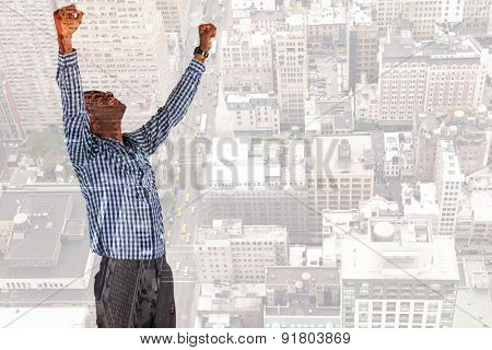 Excited businessman cheering against new york