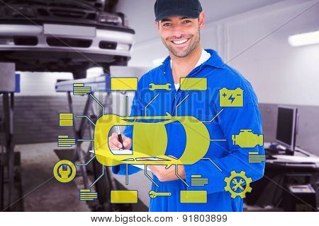 Handyman in blue overall writing on clipboard against auto repair shop