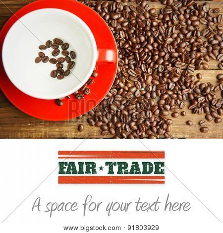 Fair Trade graphic against coffee beans in cup